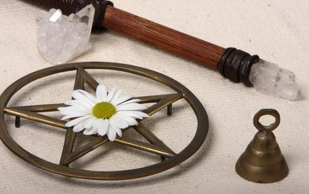 magick: close up of wiccan objects - pentacle wand bell crystal and flower Stock Photo