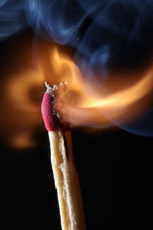 igniting: close up macro of igniting burning match Stock Photo