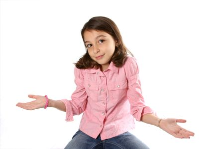 shrugging: Young girl  child shrugging shoulders against white background
