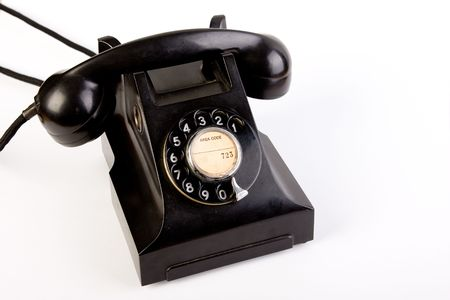 bakelite: retro vintage black bakelite telephone on white background Stock Photo