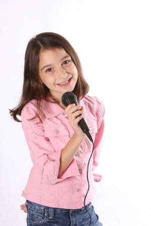child singing: Young girl  child singing in microphone against white background