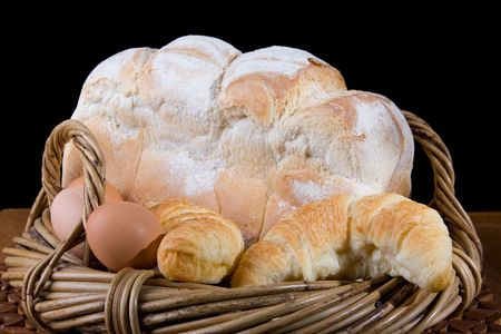 brean: close up of fresh baked brean croissants and eggs in wicker basket Stock Photo