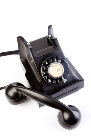 bakelite: vintage  retro black bakelite telephone on white background