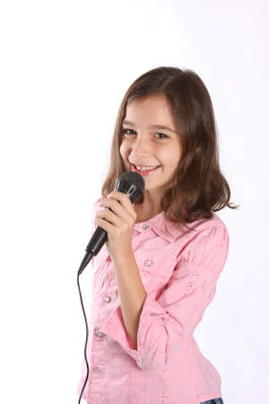 girl headphones: Young girl  child using microphone - against white background