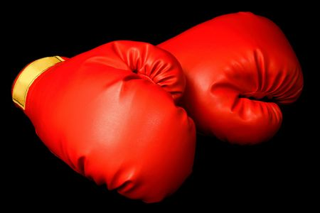 cushioned: Boxing Gloves Isolated on Black Stock Photo