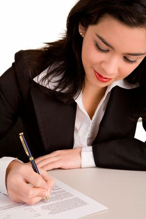 Young Businesswoman is Signing a Document photo