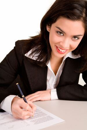 Beautiful Young Woman Signing a Document photo