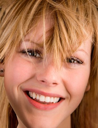 untidy: Close-up of a Young Blonde Girl with Messy Hair.