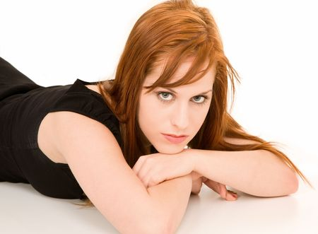 Beautiful Redhead Lying Down and Looking at the Camera photo