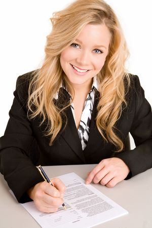 Beautiful Businesswoman Signing a Document photo