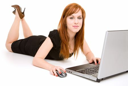 Redhead Lady Relaxing while Using Laptop photo