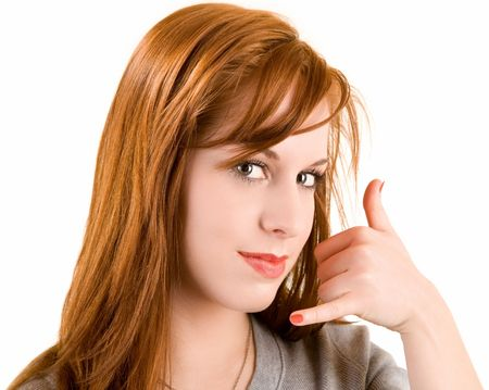 A beautiful redhead lady is doing a call me sign.  photo