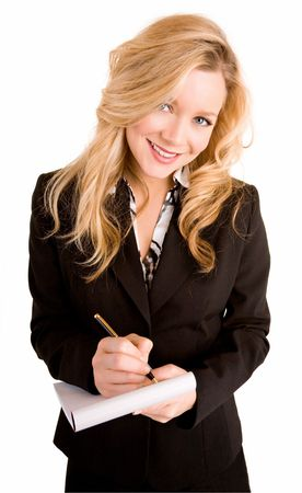 A beautiful young  businesswoman woman is taking notes. photo