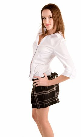 Beautiful young lady wearing a blouse and a plaid skirt. photo