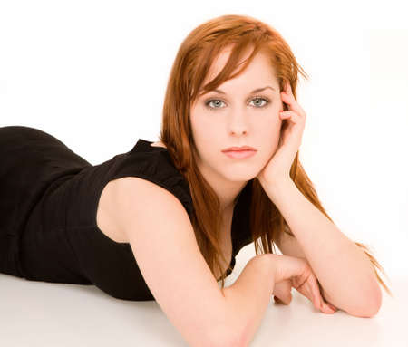 This is a portrait of a beautiful redhead girl. photo