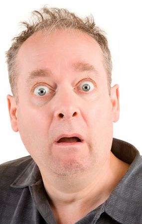 uptight: The face of a man being afraid of something. Stock Photo