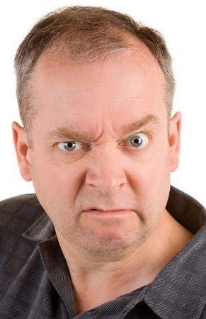 Portrait of a grumpy middle aged man.
