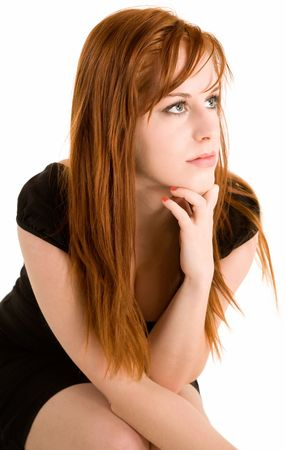 Beautiful redhead lady posing for the camera. photo
