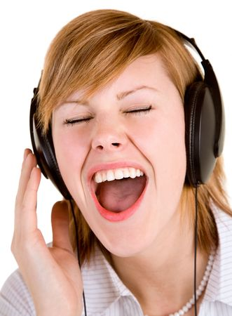 auditory: Beautiful Lady Listening to Music with Headphones.