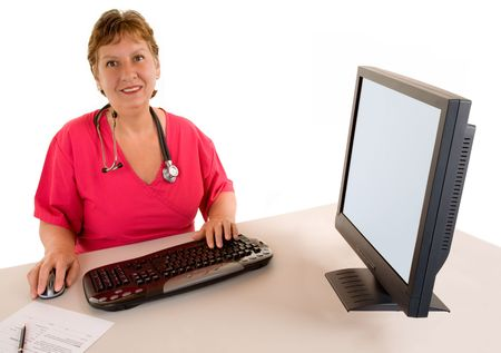 amiable: Smiling Beautiful Middle Aged Nurse or Doctor  Sitting at her Desk