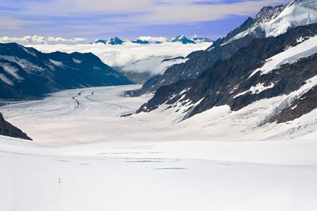 aletsch: Two Hikers Walking Towards the Aletsch Glacier in the Alps, Switzerland