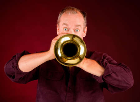 entertainers: Front View of a Trumpet Player Stock Photo
