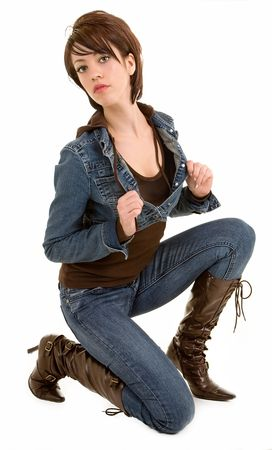 brown: Attractive Brunette Lady Posing Creatively Wearing Jeans and Leather Boots Stock Photo