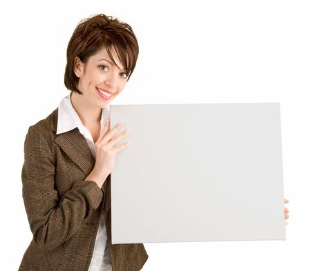A beautiful businesswoman is holding a blank white sign. Stock Photo - 3804766