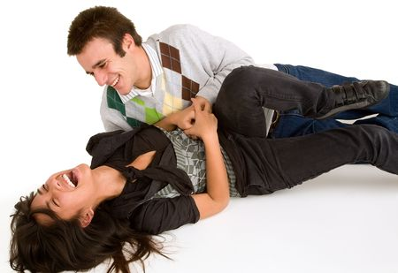 Young Girl being Tickled by Young Man   Stock Photo