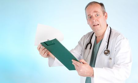 bewildered: Perplexed Doctor Reading Out Disappointing Medical Test Result Stock Photo