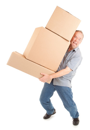 painfully: Man Painfully Carrying Boxes Stock Photo