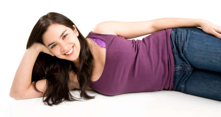 lying down on floor: Beautiful Smiling Young Woman Lying Down and Relaxing  Stock Photo