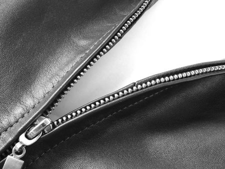 black and white fragment of a metallic zipper in a leather jacket Stock Photo