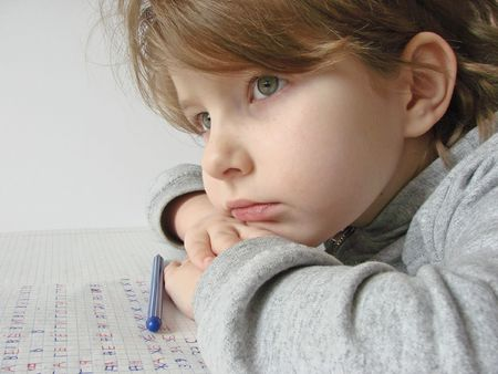 ballpen: the small girl with a ball-pen and copy-book