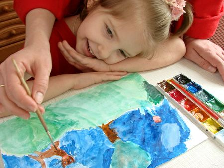 the girl studying painting with her mother Stock Photo