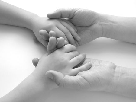 fondling: close-up of the childs hands in mothers ones