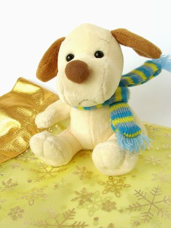 muffler: toy-puppy with a muffler sit on a nice napkin