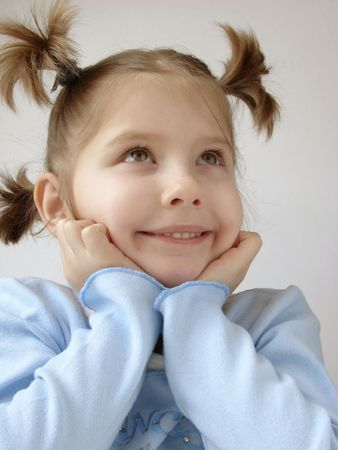 poppet: a portrait of the small pretty girl in a blue jersey