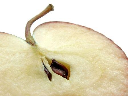 slit: Close-up foto de la lluvia de fragmentos del corte de la manzana en el fondo claro  Foto de archivo