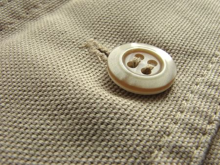 fragment: a close-up fragment of the denim trousers with a button Stock Photo