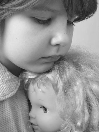 darling: portrait of the small girl with her darling doll