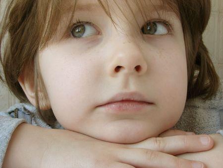 naivete: portrait of the small pretty girl