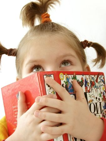 portrait of the small pretty girl with book                                photo