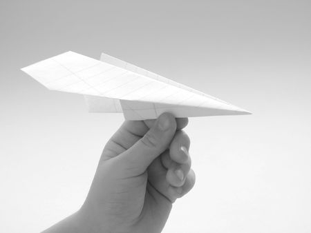 childs hand with paper plane                                photo