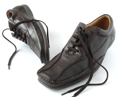 lacing sneakers: brown leather moccasins on the white background