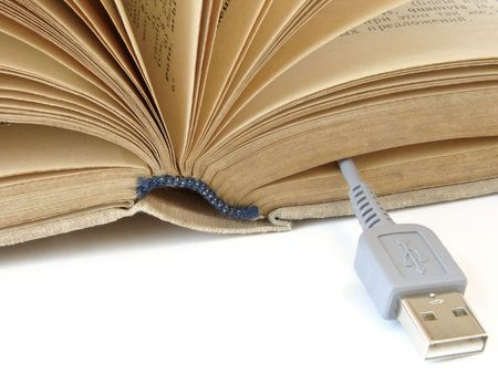 bibliophile: fragment of the opened book with usb cable