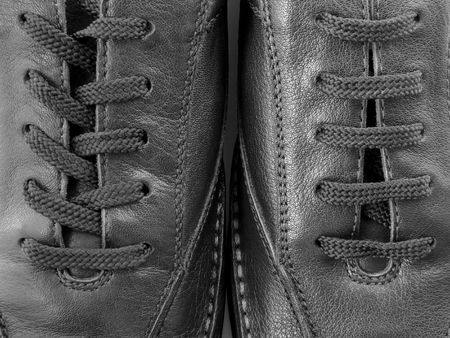 lacing sneakers: close-up fragment of the leather moccasins                                Stock Photo