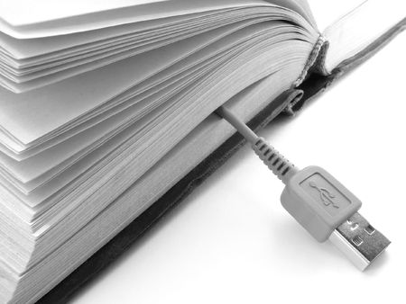 usb port: fragment of the opened book with usb cable