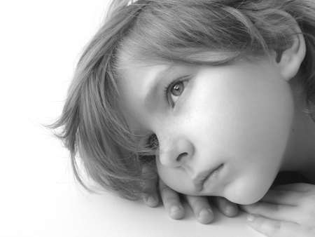 black and white portrait of the small pretty thoughtful girl