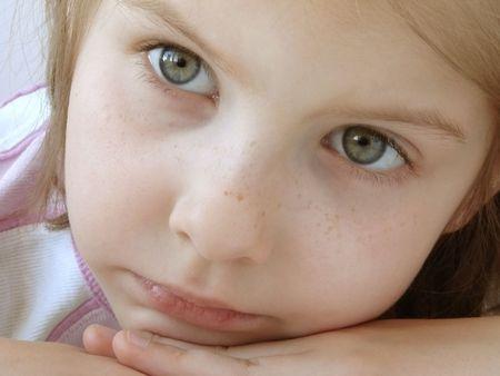 naivete: portrait of the small pretty girl                                Stock Photo